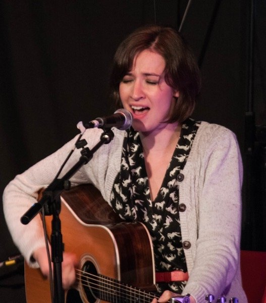 Jenn Butterworth playing on stage at the Arran Folk Festival in 2014